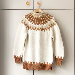 Cream, beige and rust-coloured Shetland jumper on a hanger against a taupe wardrobe
