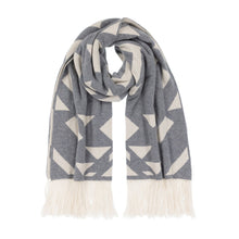 Load image into Gallery viewer, Thread Tales Geo Nomad jacquard grey and cream blanket wrap with cream fringe curled in a loop on a white background