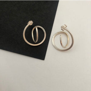 AngeB Designs' Mini Orbital earrings, handmade in recycled silver, against a black and white background