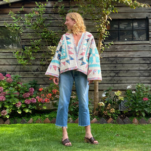 Blonde model in Sunday at the Villa's Kitty quilted kimono jacket
