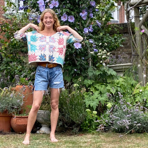 Blonde model in Sunday at the Villa's Suki quilted sweatshirt with country garden background
