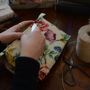 Forget Me Not Originals Emma Williams at work, bookbinding using floral vintage textiles