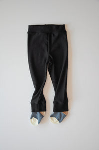 Black bamboo baby leggings with blue socks attached that won't fall off