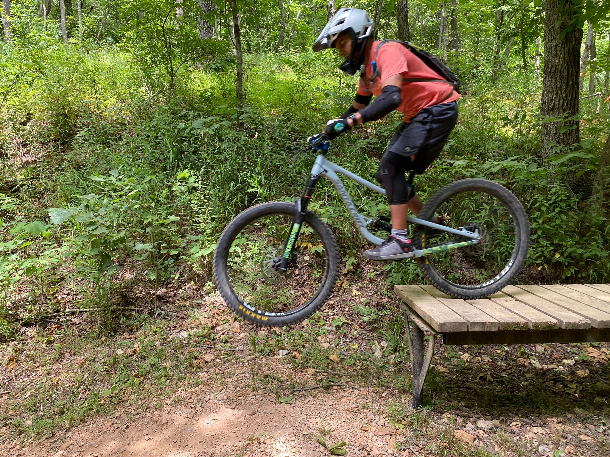 Learn to roll off drops in a Private Mountain Bike Skills Class
