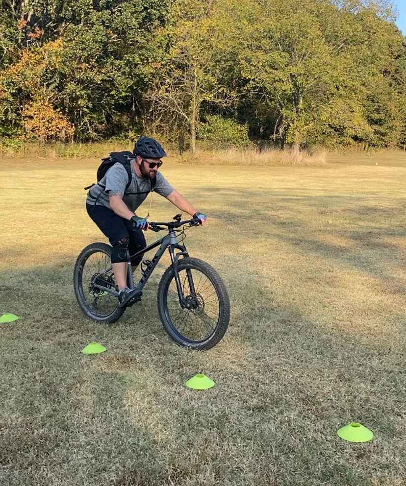 Ready position in beginner bike skills class Bentonville Arkansas