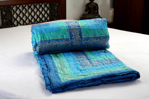 Designer Doubles cotton Razai / Quilt in Blue/Green/Turq/Gold Combo by Jodhaa
