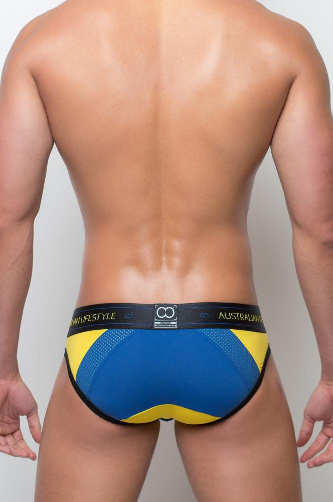 Male model wearing 2EROS CoAktiv Men's Brief - Gold