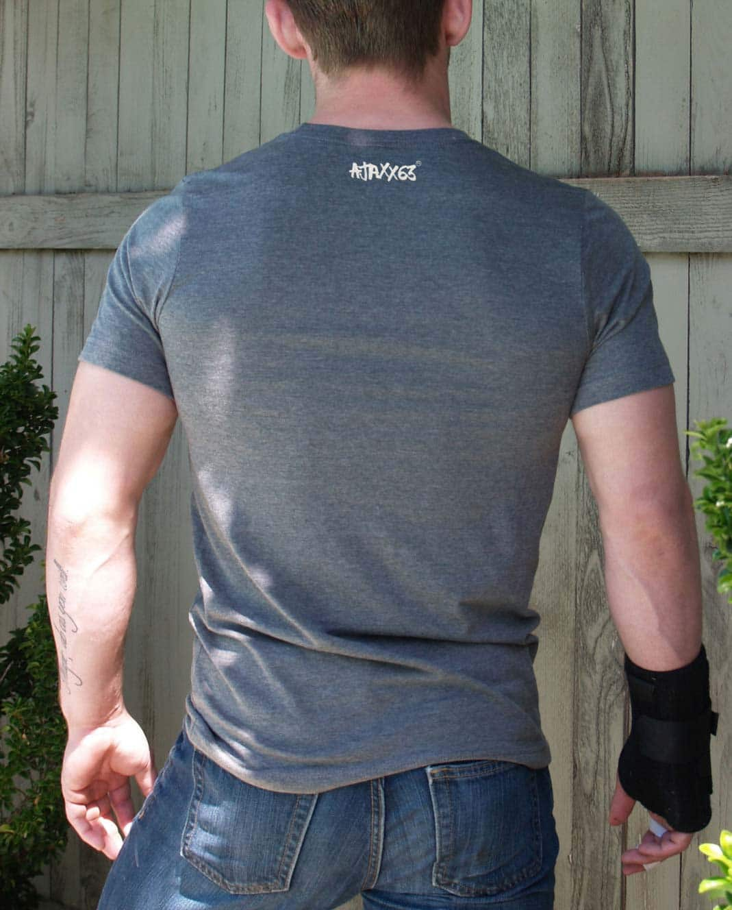 Male model wearing Ajaxx63 Greedy Hole Men's T-shirt