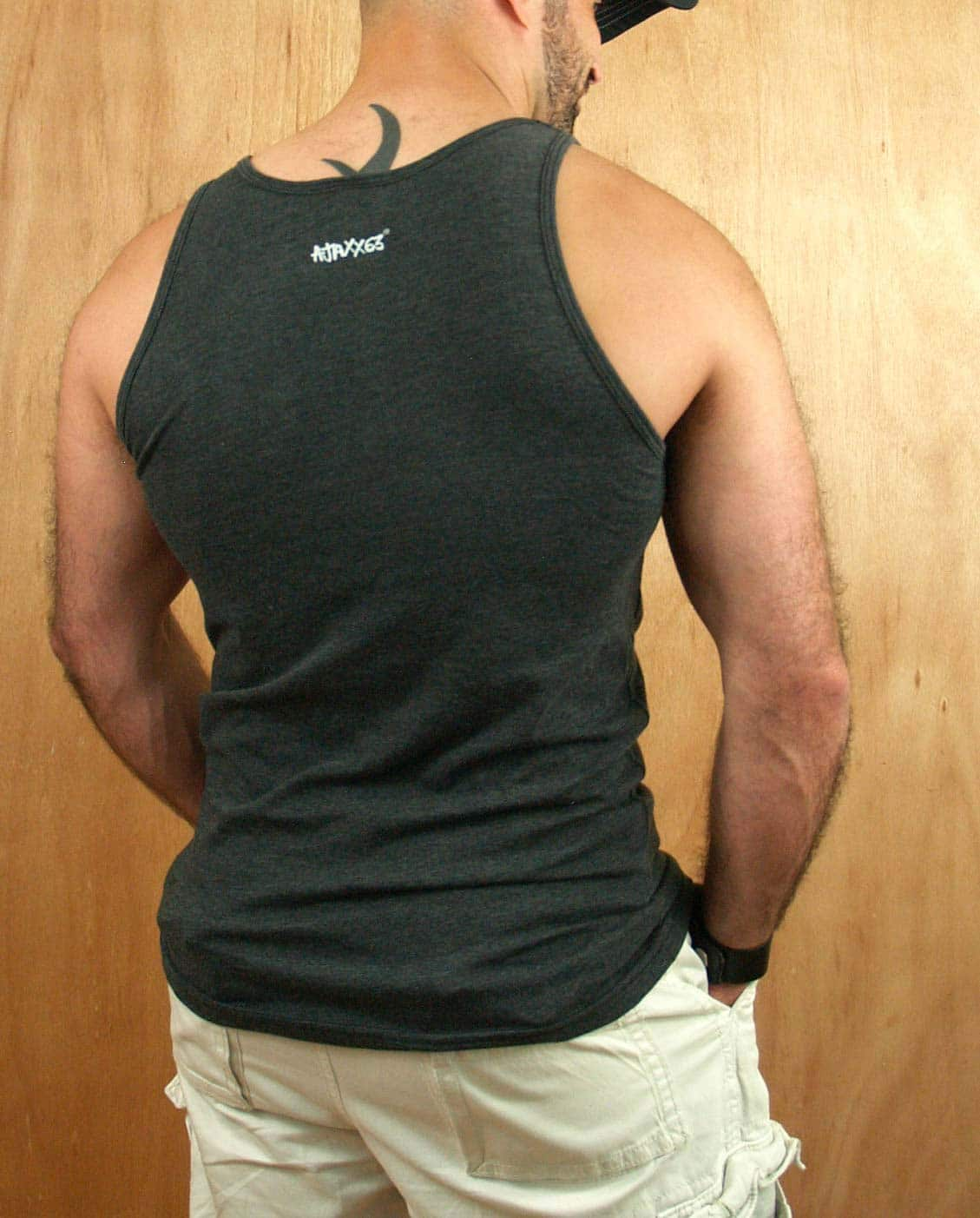 Male model wearing Ajaxx63 Chew Toy Men's Tank Top
