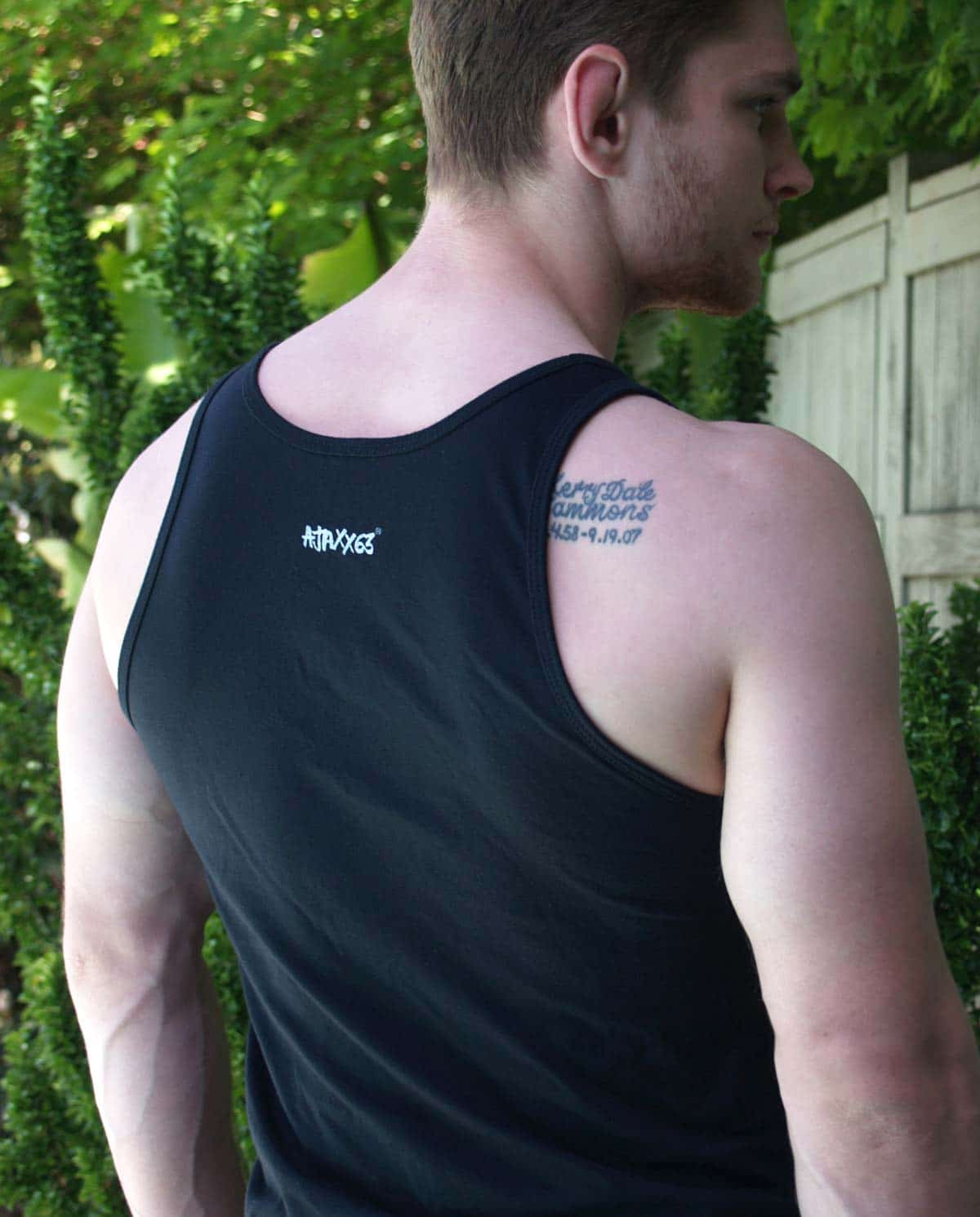 Male model wearing Ajaxx63 Pup Black Men's Tank Top