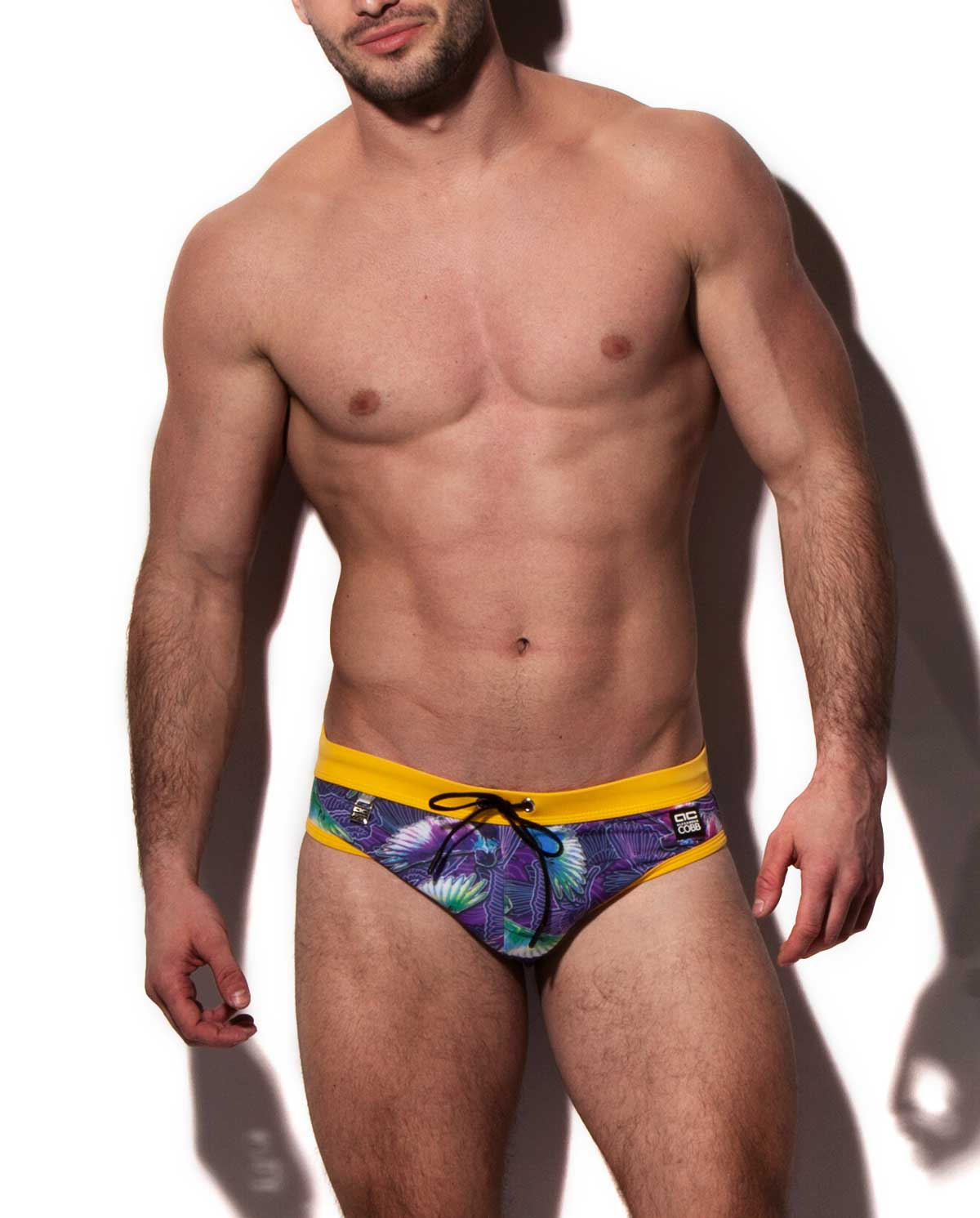 Male mode wearing Alexander Cobb ICARUS Men's Swimwear Collection available at www.MensUnderwear.io
