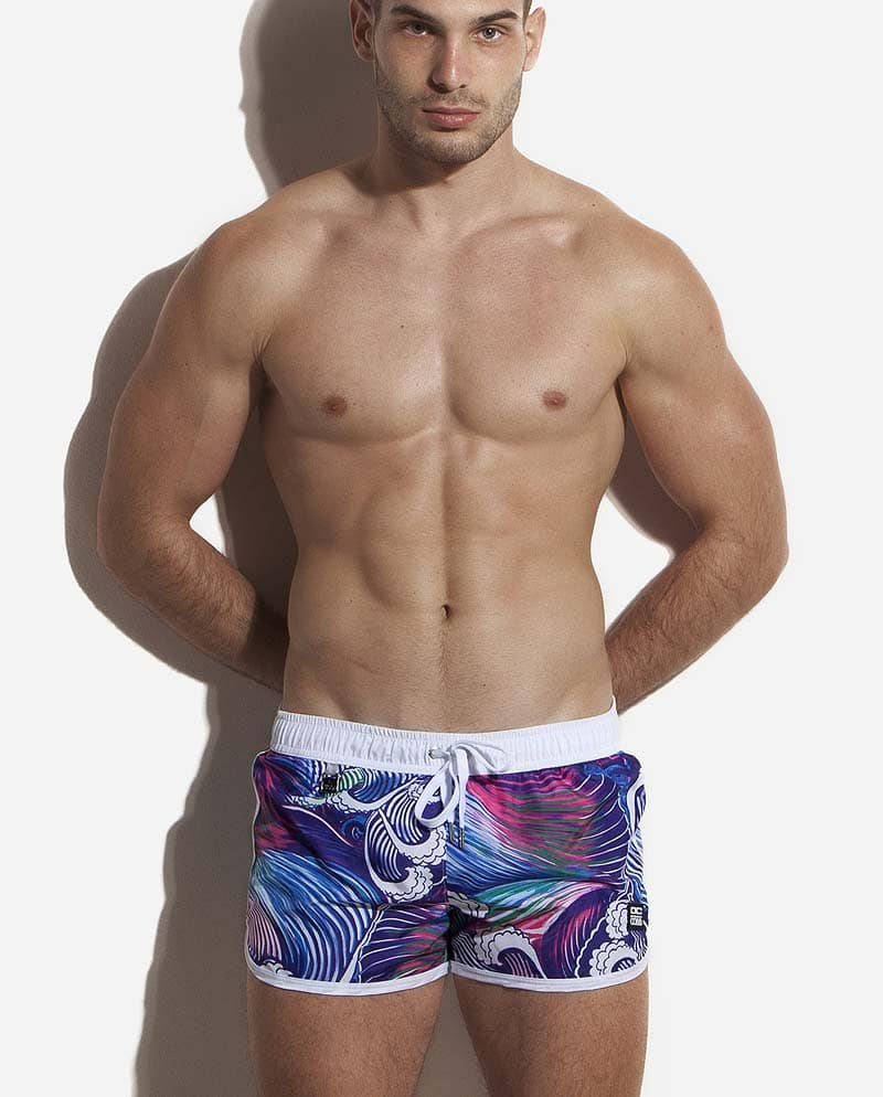 Male model wearing Alexander COBB Tasman Sea Swim Shorts for men
