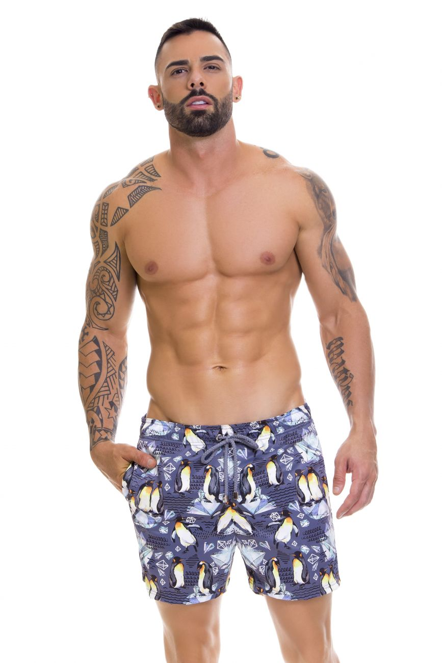 Male underwear model wearing Arrecife 0666 South Swim Trunks available at www.MensUnderwear.io
