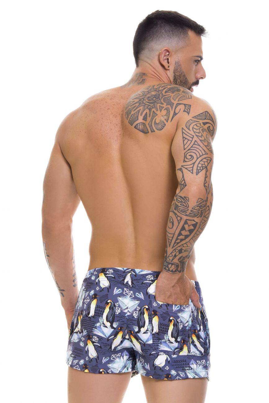 Male underwear model wearing Arrecife 0667 South Swim Trunks available at www.MensUnderwear.io