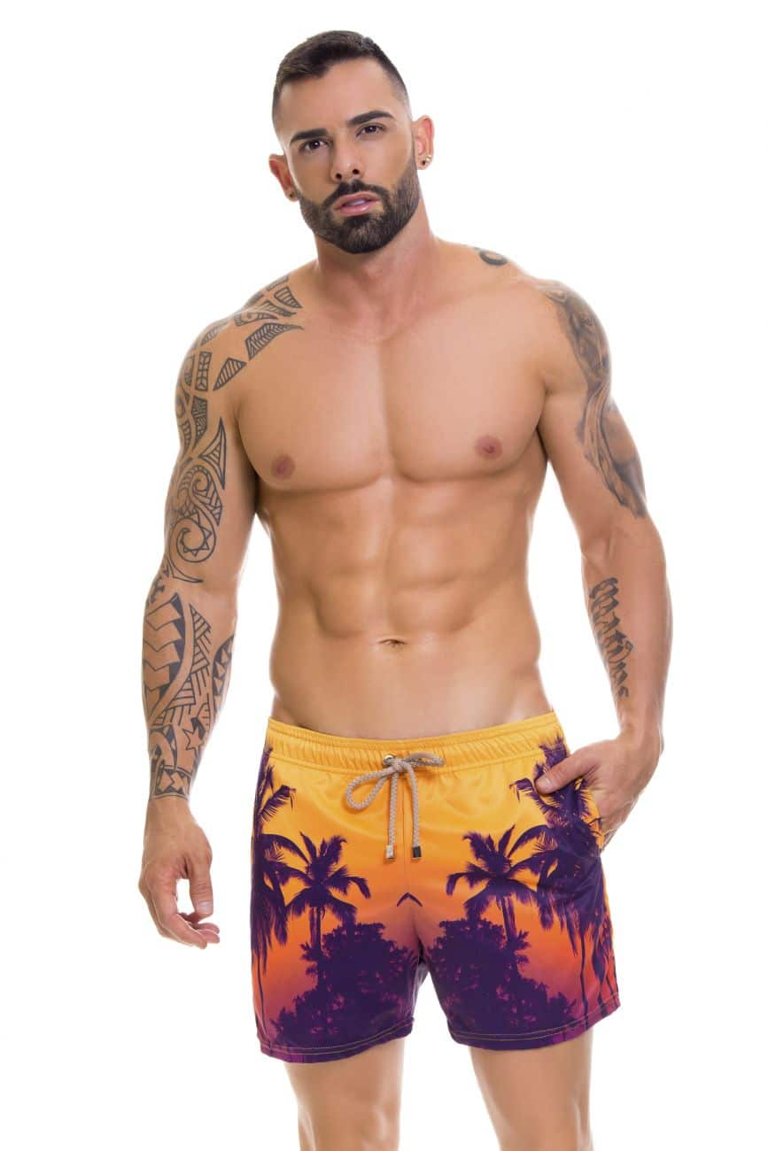 Male underwear model wearing Arrecife 0696 Short Swim Trunks available at www.MensUnderwear.io
