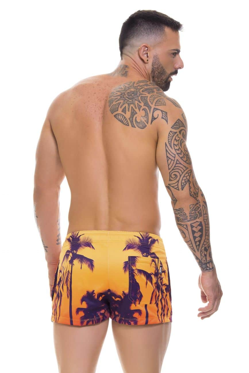 Male underwear model wearing Arrecife 0697 Mini Swim Trunks available at www.MensUnderwear.io