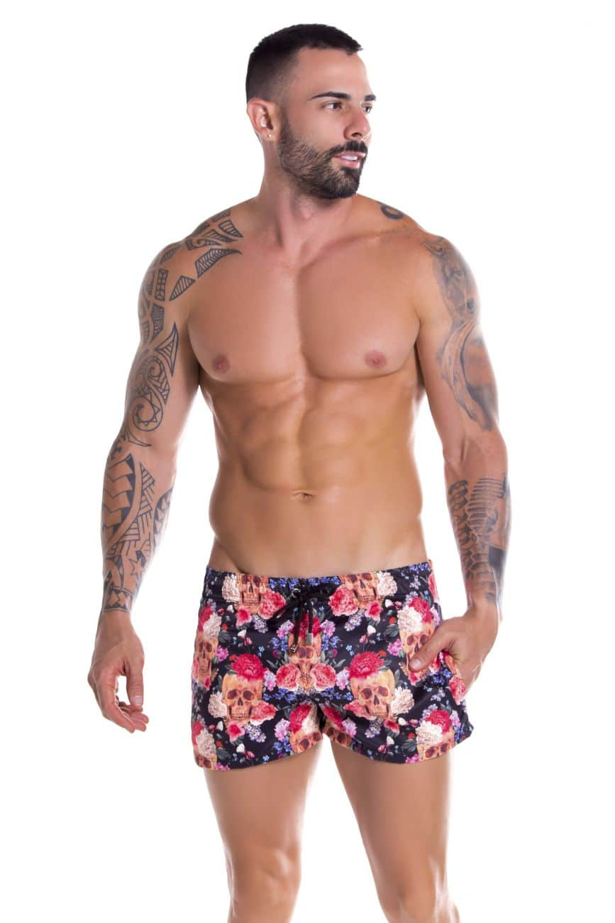 Male underwear model wearing Arrecife 0906 Tabasco Swim Trunks available at www.MensUnderwear.io