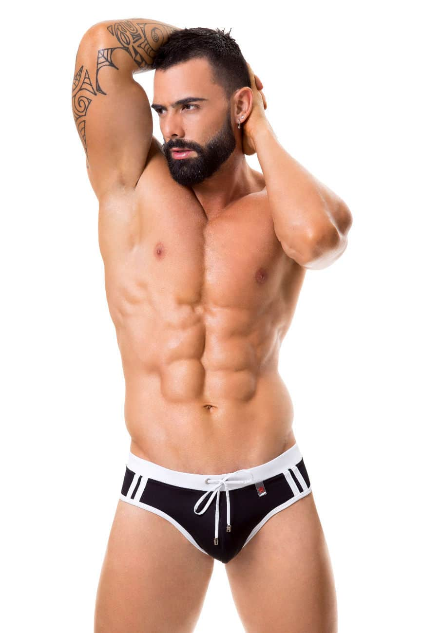 Male underwear model wearing JOR 0355 Sport Swim Thongs available at www.MensUnderwear.io