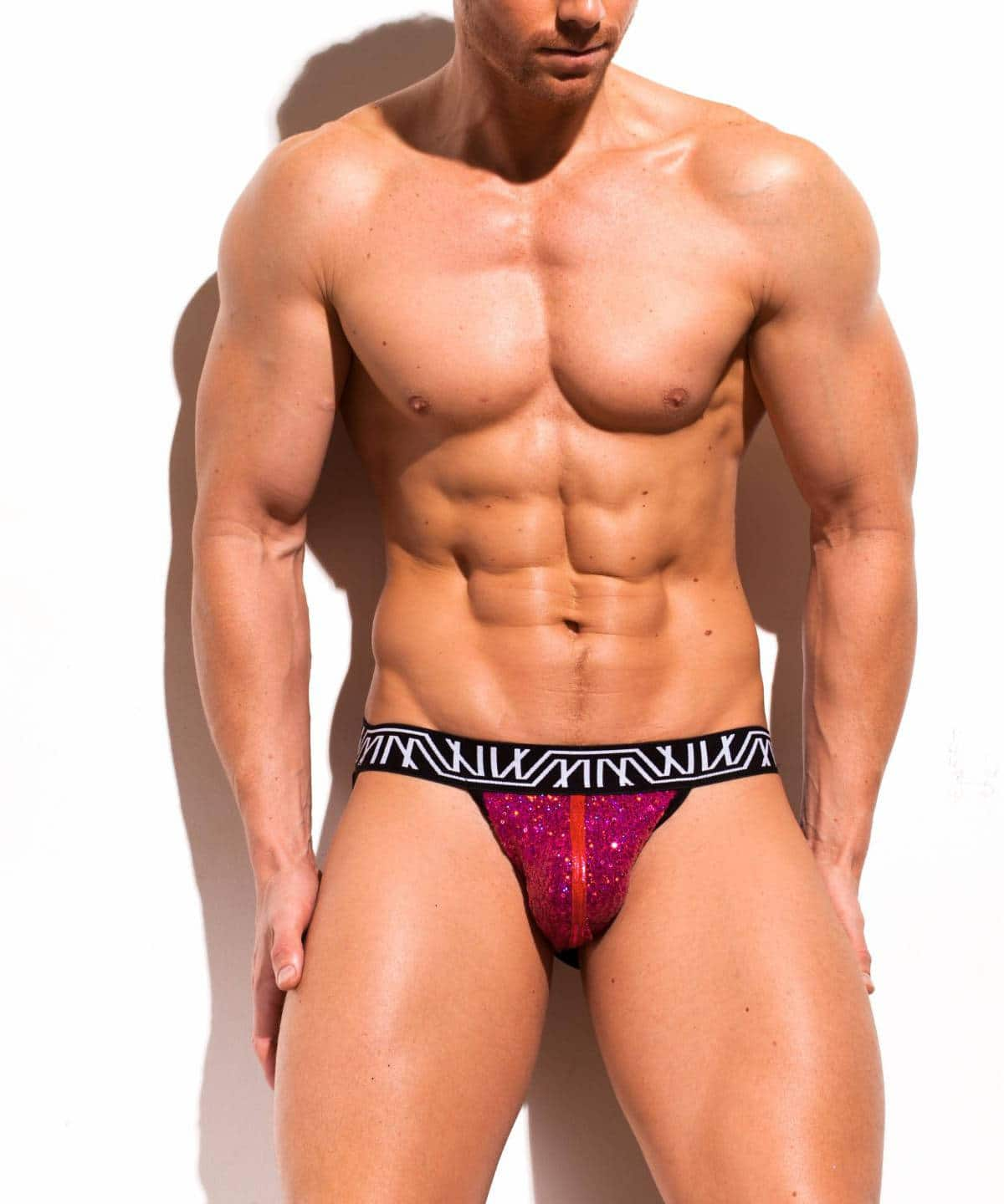 Male model wearing Marco Marco Pink Sequin Jock-Thong for men