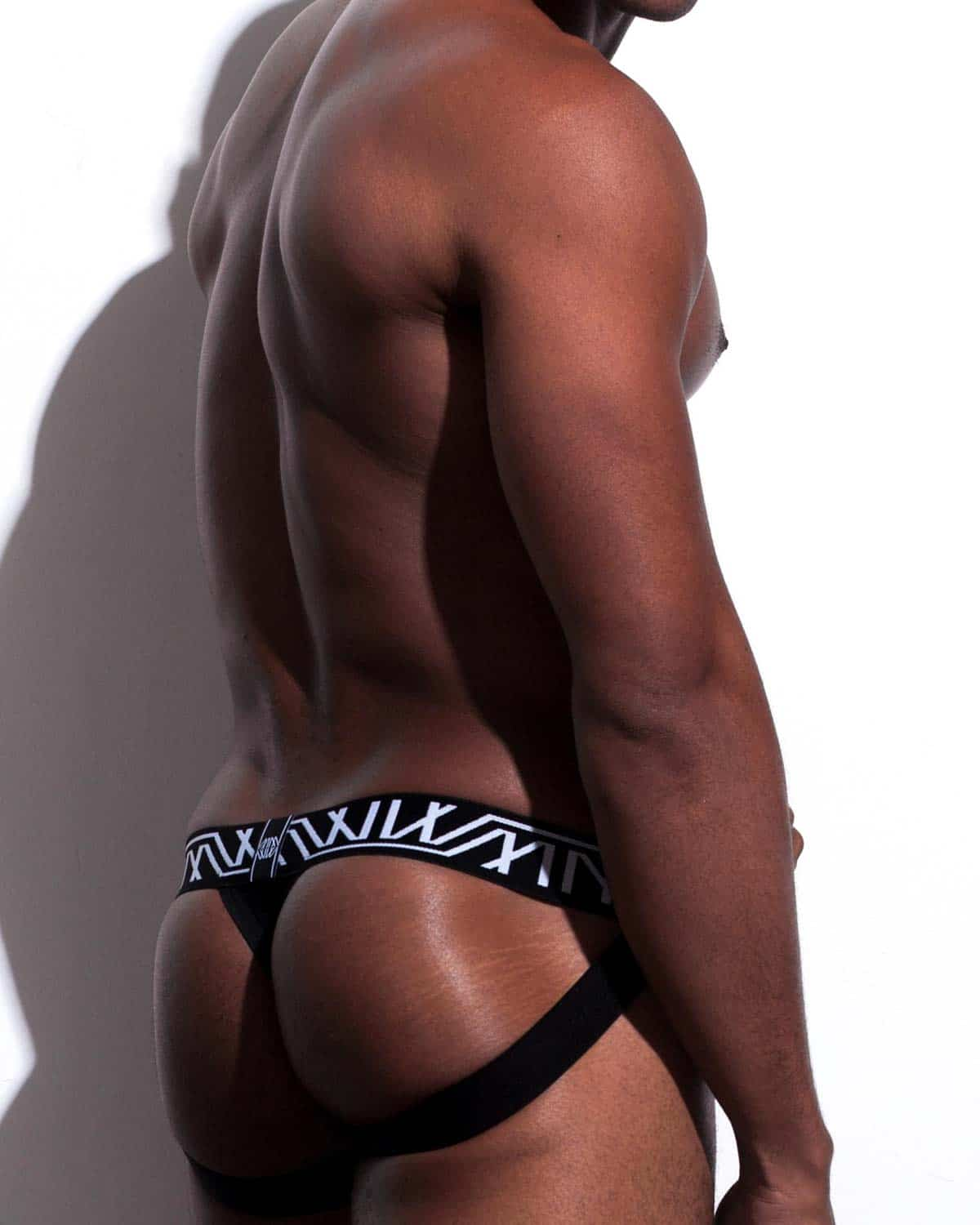 Male model wearing Marco Marco Black Sequin Jock-Thong for men available at MensUnderwear.io