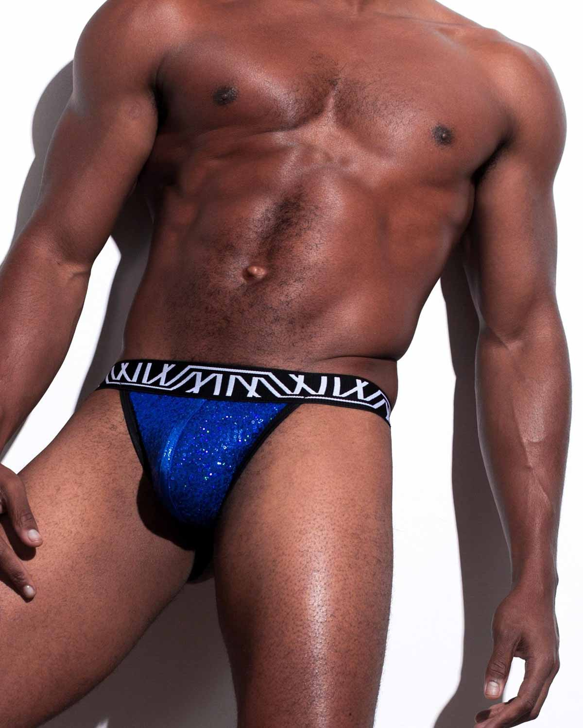 Male model wearing Marco Marco Blue Sequin Jock-Thong for men available at MensUnderwear.io