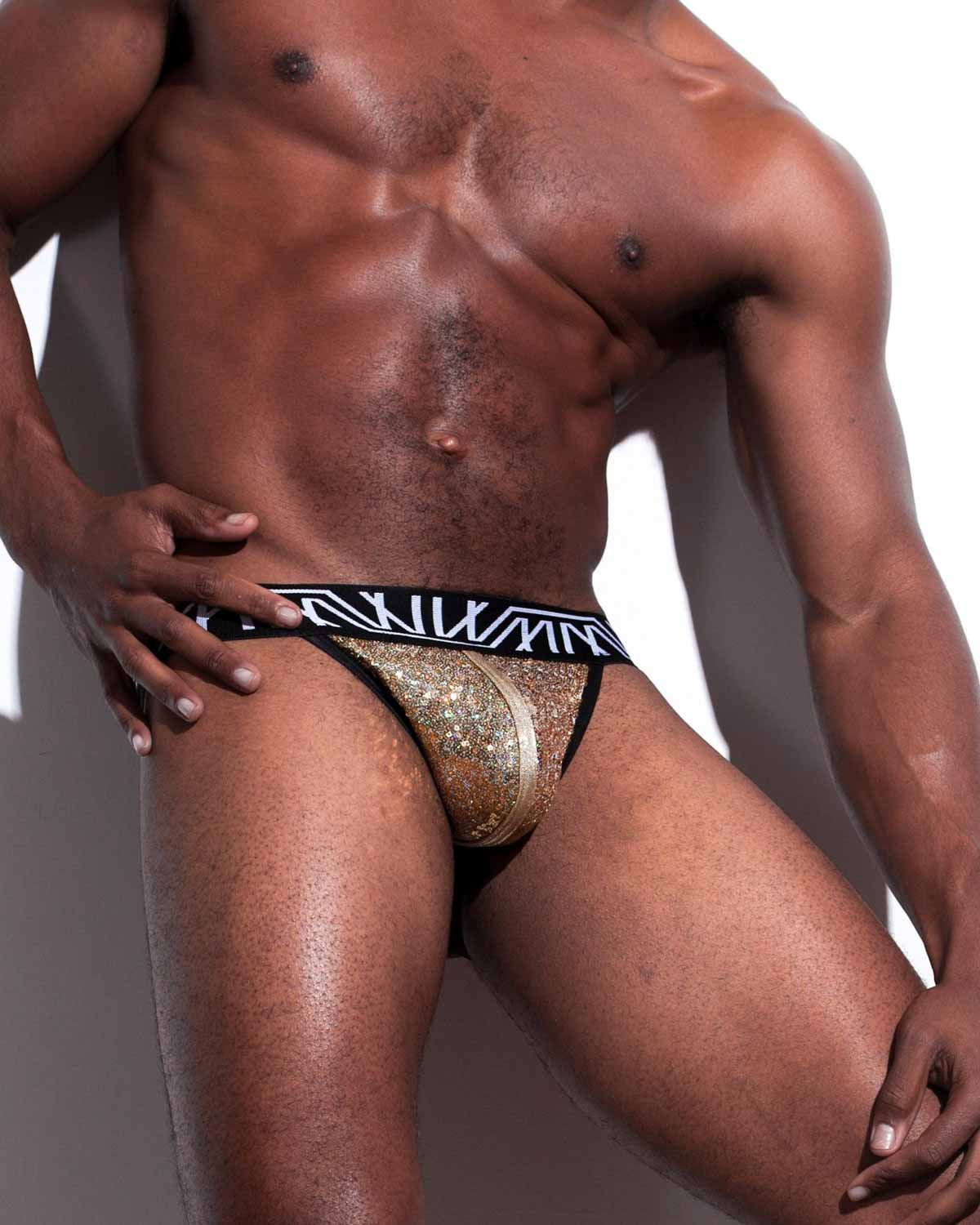 Male model wearing Marco Marco Gold Sequin Jock-Thong for men available at MensUnderwear.io