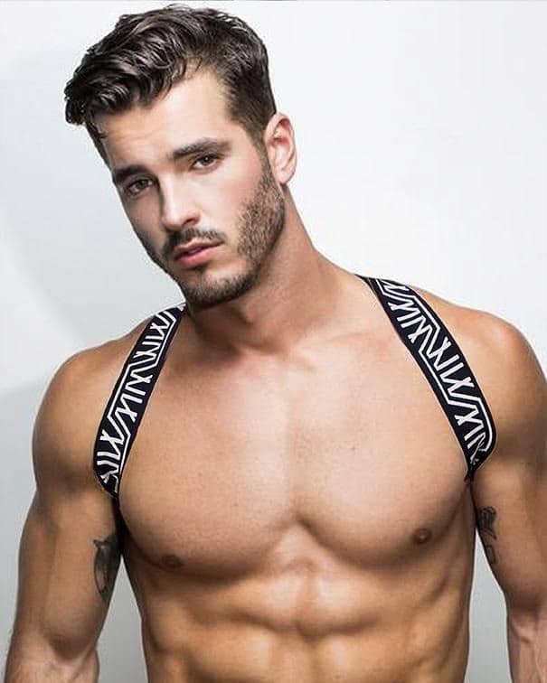 Male model wearing Marco Marco Men's MM Logo Harness available at MenUnderwear.io