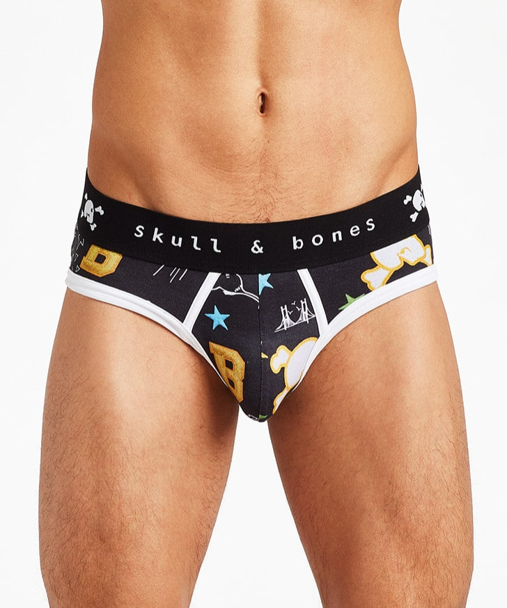 Male model wearing Skull & Bones Underwear Graffiti Brief - Black - Available at MensUnderwear.io