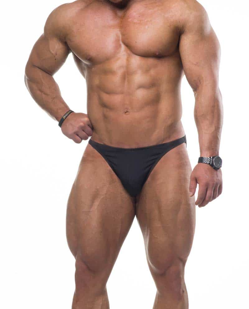 Male bodybuilder model wearing Jed North Bodybuilding Posing Trunks