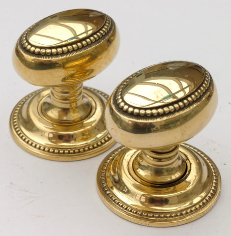 Georgian, Antique Brass Turning Door Handles with Screw Cover Plate