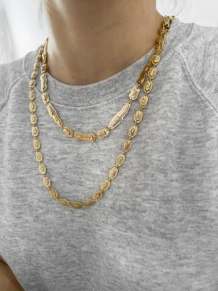 Jewellery stories by Kay Konecna | layered necklaces in gold vermeil with a grey hoodie. Shop online at www.kaykonecna.com