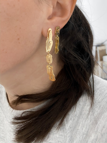 Jewellery stories by Kay Konecna | layered multiple earrings in gold vermeil with a grey hoodie. Shop online at www.kaykonecna.com