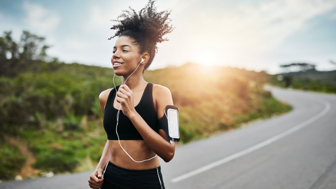 happy woman running at sunrise for her health
