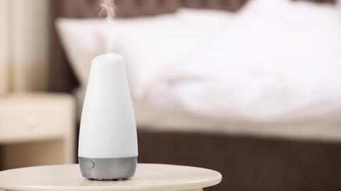 essential oil diffuser in bedroom to improve mood and sleep quality