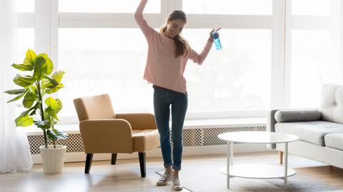 woman treating her house with non-toxic essential oil spider spray to keep pests out