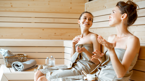 women chatting in sauna after exercise
