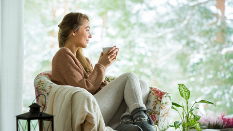 cozy woman staying healthy and bright with essential oils