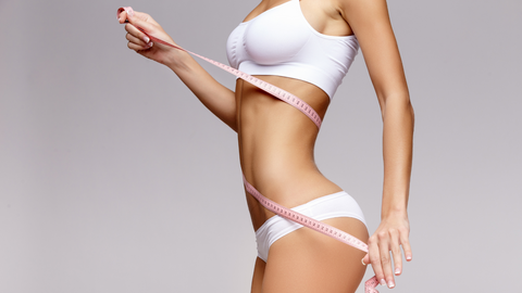 sculpted body with tape measure