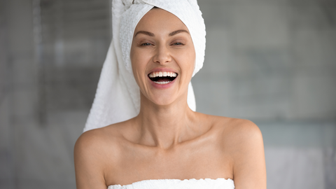 happy woman with clear wrinkle-free skin