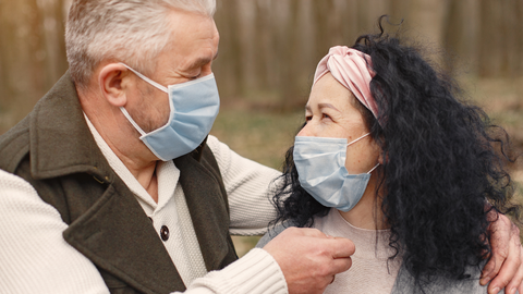 cute old couple with face masks