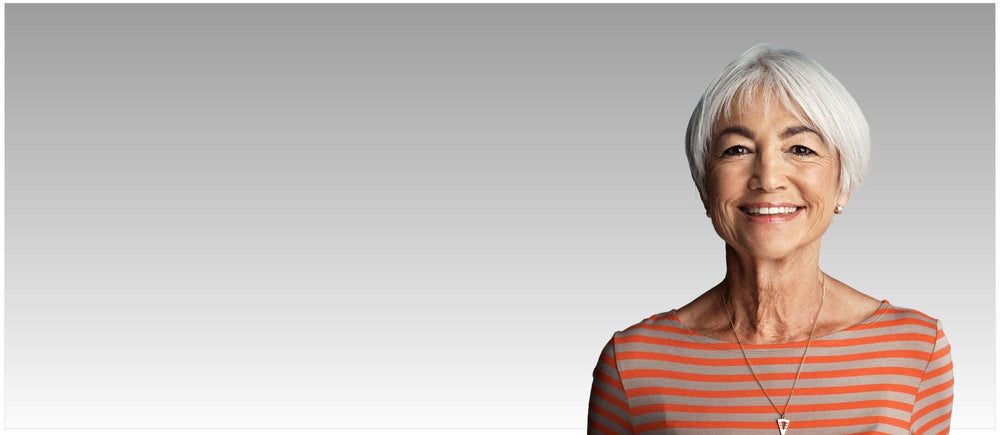 White haired woman with necklace and orange striped shirt, testimonial for UsedCardboardBoxes.