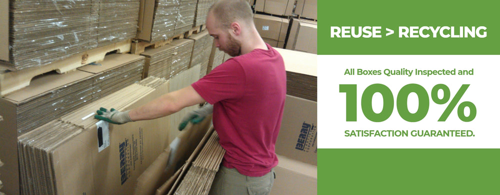 Bobby Corrigan, from UsedCardboardBoxes, inspecting used cardboard boxes for quality and integrity prior to reuse.