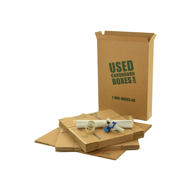 Various sizes of used moving and storage boxes shown flattened, along with included supplies, in a Studio or Dorm Room Moving Kit (SUPER) by UsedCardboardBoxes.