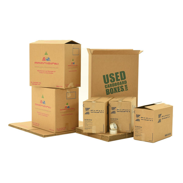 Various sizes of used moving and storage boxes shown assembled and flattened, along with included tape rolls, in a Pack Rat Moving Kit by UsedCardboardBoxes.