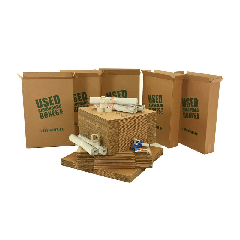 Various sizes of used moving and storage boxes shown flattened, along with included supplies, in a 4 Bedroom Moving Kit by UsedCardboardBoxes.