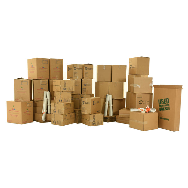 Various sizes of used moving and storage boxes shown assembled and flattened, along with included supplies, in a 7 Bedroom Moving Kit by UsedCardboardBoxes.