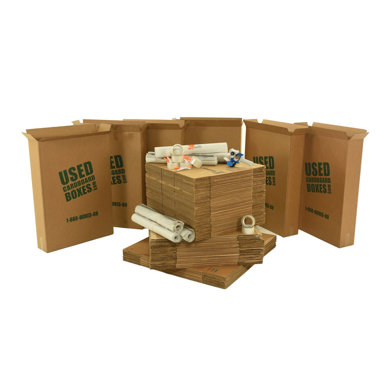 Various sizes of used moving and storage boxes shown flattened, along with included supplies, in a 6 Bedroom Moving Kit by UsedCardboardBoxes.