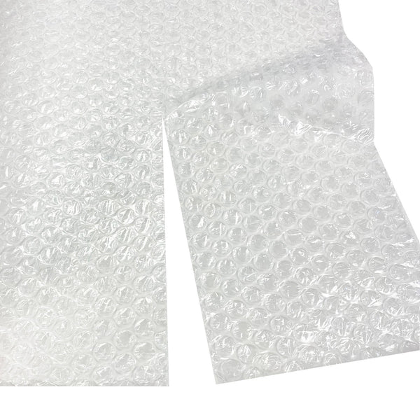 Bubble Wrap measuring 12 inches by 100 feet, each bubble measuring 5/16 of an inch, by UsedCardboardBoxes. Perforated every 12 inches for easy tearing.