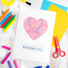 Frame your child's art behind the heart mount