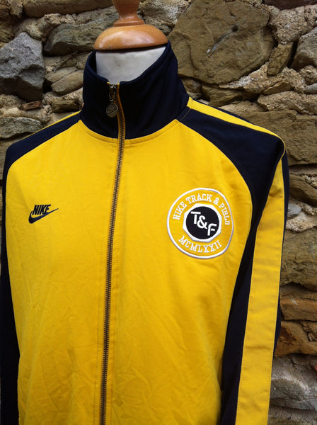 Vintage yellow Track & Field Nike Jacket